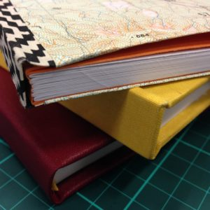 Stack of three hand-bound books